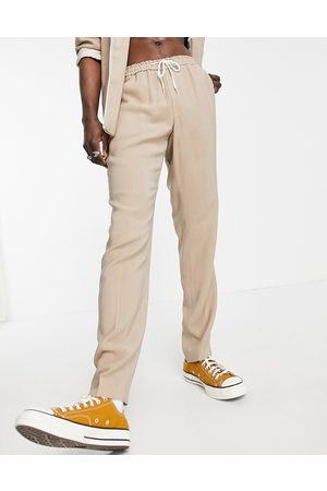 ASOS Muži Úzké nohavice - Slim fit pyjama suit trousers with piping on pocket in camel-Neutral