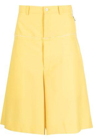 Comme des Garçons Muži Široké nohavice - Layered wide-leg suit shorts