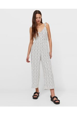 Stradivarius Wide leg strappy jumpsuit in white spot
