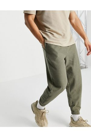 ASOS Muži Tepláky - Oversized joggers in waffle-Green