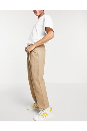 ASOS DESIGN Wide leg trousers with pleats in beige linen mix-Neutral