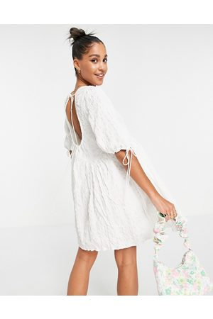 ASOS Textured cut out back detail mini smock dress with ties in white
