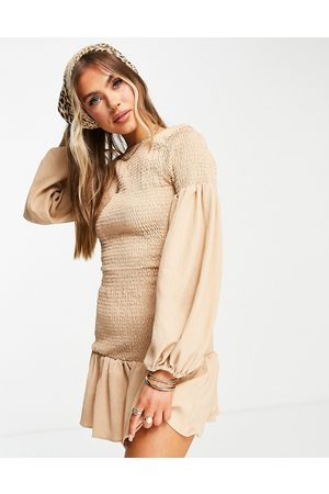 ASOS Shirred mini dress with bubble sleeve and pep hem in beige-Neutral