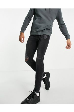 The Couture Club Distressed super skinny jean in washed black