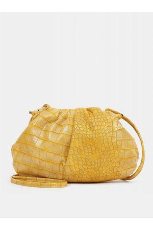 Tamaris Žlutá vzorovaná malá crossbody kabelka