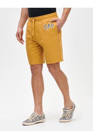 GAP Žluté pánské kraťasy Logo mini arch shorts