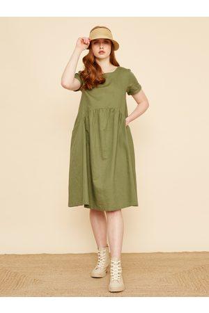 Zoot Zelené volné lněné šaty s kapsami Medeline