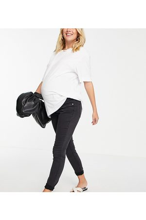 ASOS ASOS DESIGN Maternity high rise ridley 'skinny' jeans in washed black with over the bump waistband