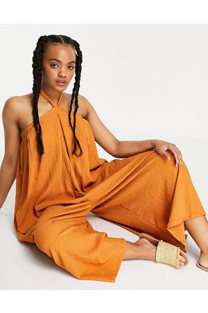ASOS Ženy Overaly dlouhé - Cross neck textured swing smock jumpsuit in tobacco-Brown