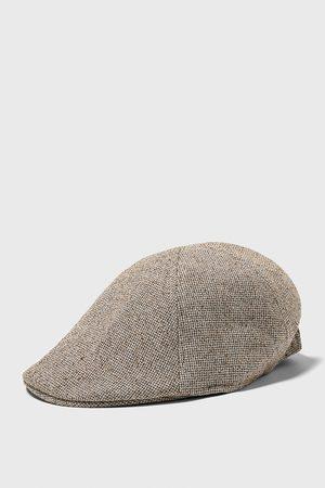 Zara čepice s pruženkou