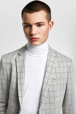 Zara Kostkované oblekové sako comfort knit 4 ways