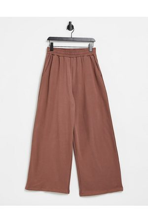 ASOS Muži Tepláky - Co-ord oversized wide leg joggers in washed brown
