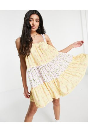 ASOS Tiered mini strappy sundress in pastel mix match floral print-Multi