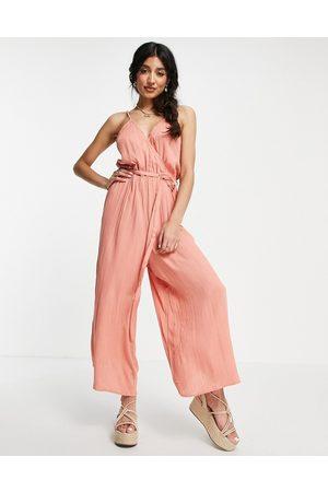 ASOS DESIGN Wrap front cami culotte trim jumpsuit in rust-Brown