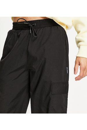 COLLUSION Ženy Kapsáče - Nylon cargo trousers with pockets in black