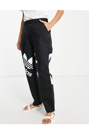 adidas Ženy Společenské - X Dry Clean Only tailored trousers in black with trefoil tee inserts