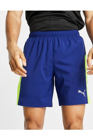 PUMA Running Favourite short in blue with under layer tight