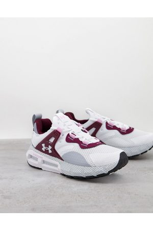 Under Armour Running HOVR Mega MVMNT trainers in white and pink