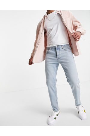 ASOS Stretch tapered jeans in tinted light wash-Blue
