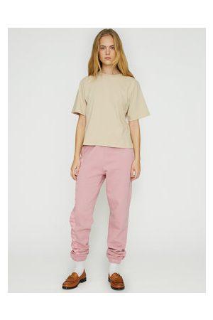 ROTATE Ženy Tepláky - Teplákové kalhoty