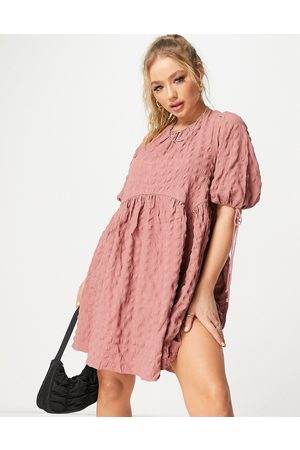 ASOS Textured cut out back detail mini smock dress with ties in pink