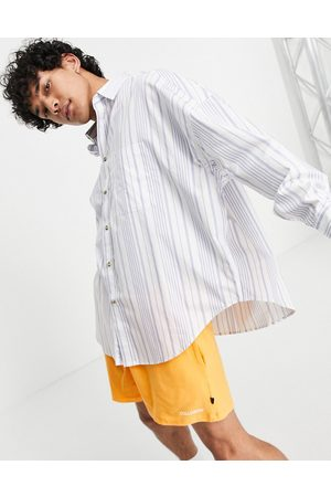 ASOS Extreme oversized shirt in navy stripe with curved hem-White