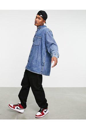 ASOS DESIGN Extreme oversized denim shirt in acid wash-Blue