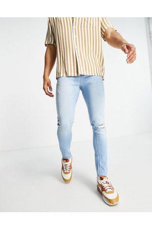 ASOS Spray on jeans with power stretch in light wash blue with knee rip