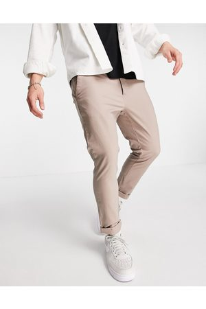ASOS Super skinny cropped chinos in beige-Neutral