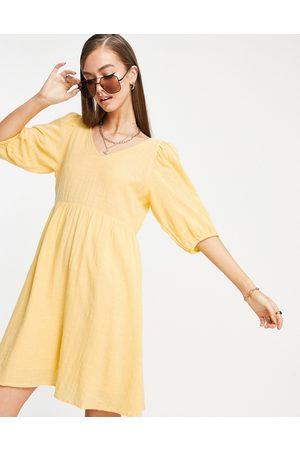 VERO MODA Mini smock dress with cross back in yellow