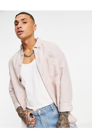 ASOS DESIGN 90s oversized linen shirt in pink