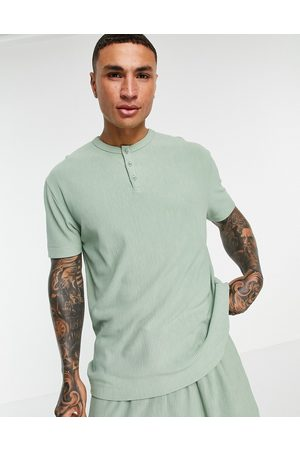 ASOS Relaxed heavyweight rib t-shirt with half sleeve in washed green