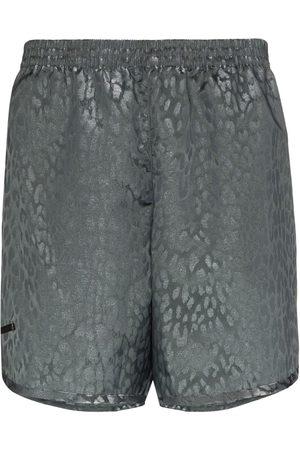 TRUE TRIBE Muži Šortky - Metallic sheen leopard print swim shorts