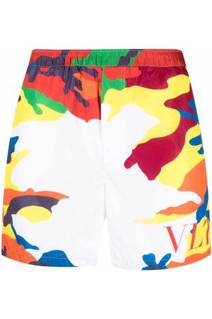VALENTINO Logo-print camouflage swim shorts