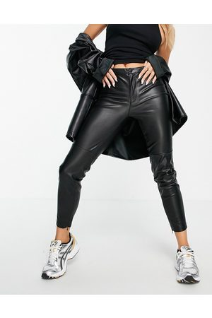 MANGO Faux leather trousers in black