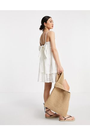 ASOS Bandeau double layer tie back mini sundress in broderie in white