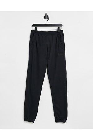 adidas Muži Tepláky - RYV joggers in black