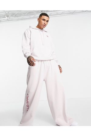 ASOS Muži Teplakovka - Co-ord extreme oversized jogger with seam details & leg logo print in lilac-Purple