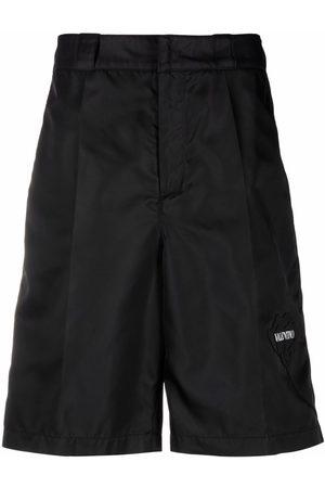VALENTINO Muži Bermudy - Logo-print knee-length shorts