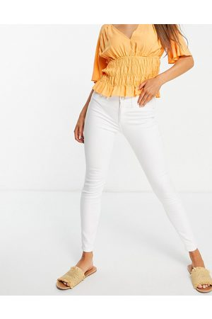 River Island Molly skinny jeans in white