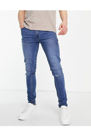 Threadbare Super skinny fit jeans in light blue with knee rips