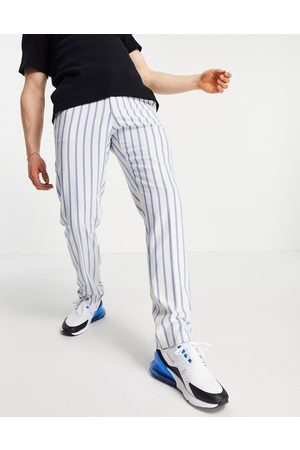 ASOS Slim soft tailored suit trousers with blue stripe and jogger waistband