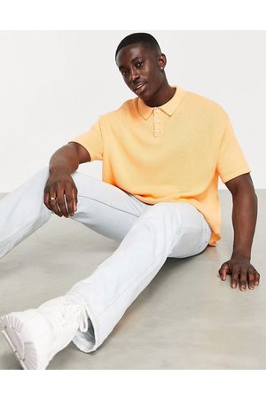 ASOS DESIGN Knitted midweight polo t-shirt in peach-Pink