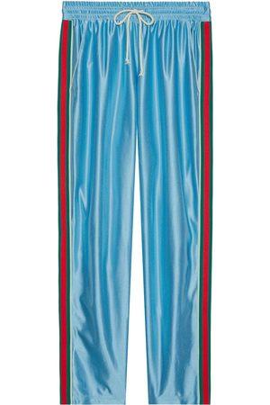 Gucci Web stripe shiny jersey track pants