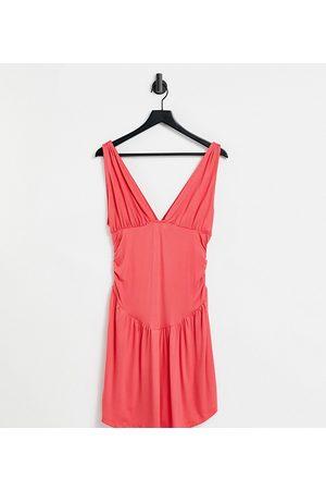 ASOS ASOS DESIGN Petite plunge ruched waist curved hem skater mini dress in coral-Pink