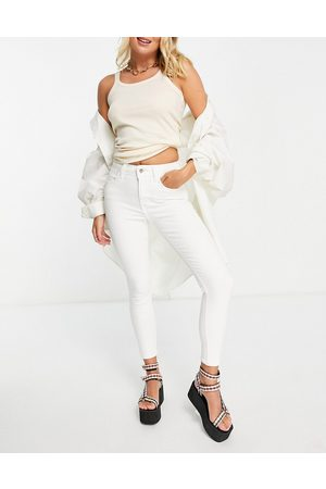 Topshop Four skinny jeans in white