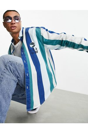 ASOS 90s oversized vertical stripe twill shirt with basketball embroidery-Blue