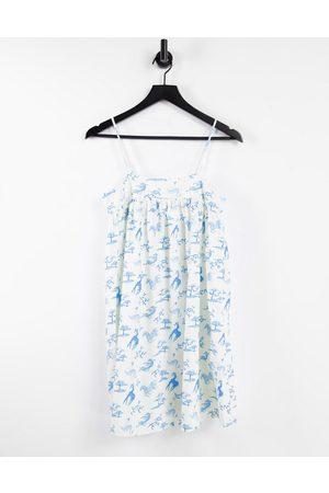 ASOS Mini smock seam sundress in cream and blue animal conversational print-White
