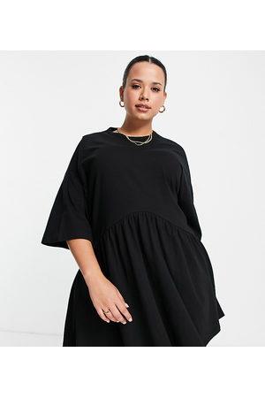 ASOS Ženy Volnočasové - ASOS DESIGN Curve oversized mini smock dress with dropped waist in black