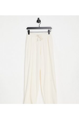 ASOS Petite ASOS DESIGN Petite straight leg jogger with deep waistband and pintuck in organic cotton in cream-White